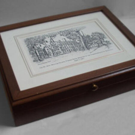 Eglomise desk boxes. Medium desk boxes are 11 1/4'' x 8 7/8'' x 2 1/2'' and depict either Johnson Gate ($193.76), Mass Hall ($197.47), or John Harvard ($197.47). Mini desk boxes contain the same designs (all mini designs are $165.17)