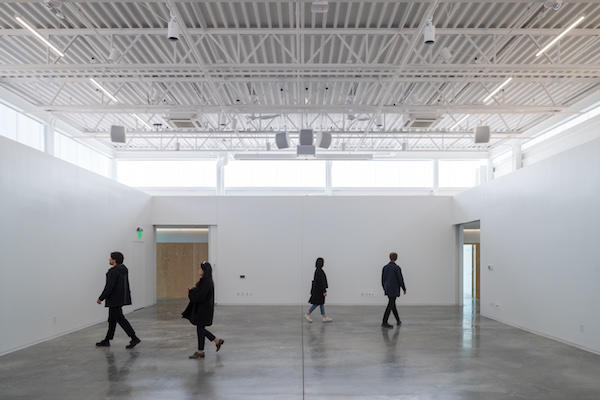 Students walking through the ArtLab space.