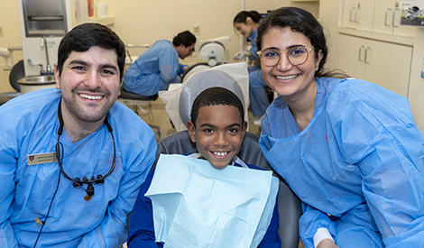photo of dental students with pediatric patient