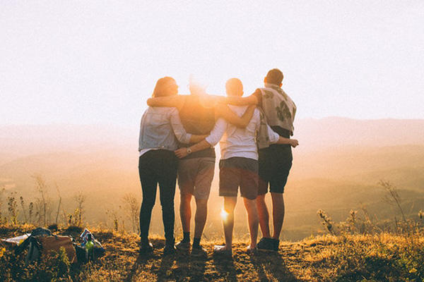 image of 4 people watching a sunset