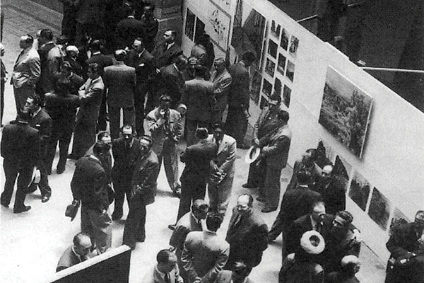 black and white photo of people in a museum