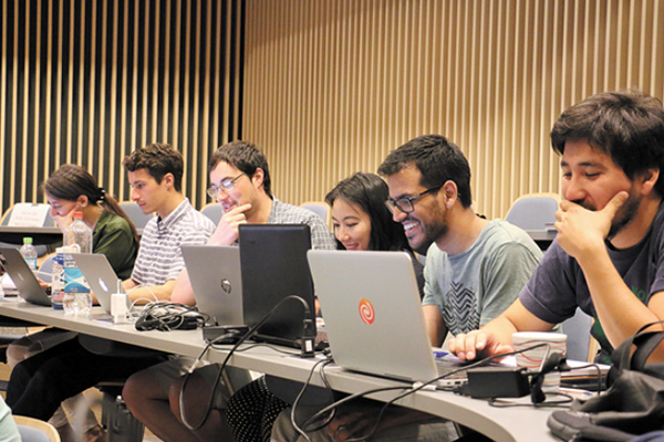 students with laptops participating in a data exchange in Chile