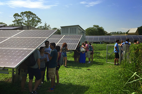 students visiting solar research facility in Sao Paolo, Brazil