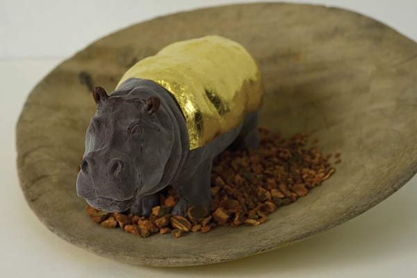Hippo in Batea with Quinine II, 2020, batea, chocolate, 24 karat gold leaf, quinine bark, 13.5'' ø x 2.5''