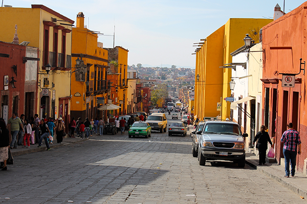 busy mexico street with people and cars