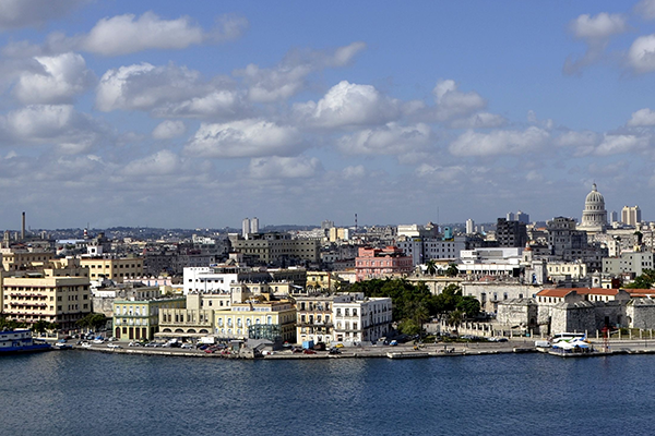 shoreline of beach and buildings in Cuba