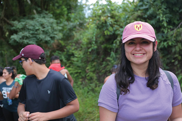 student smiling in a wooded area in Brazil