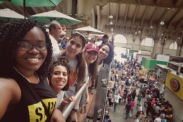 students in a Brazilian market