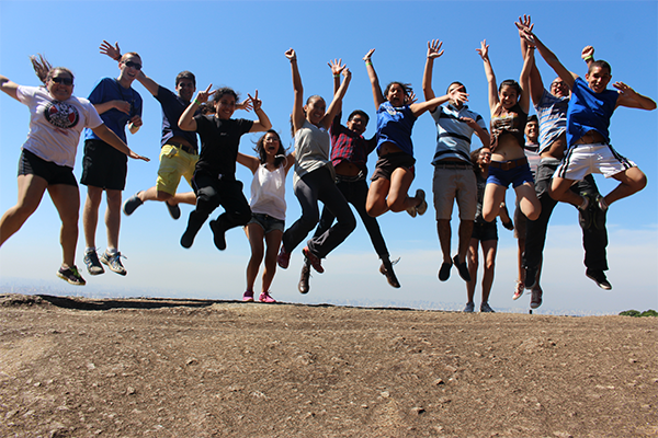 students jumping outside in Argentina