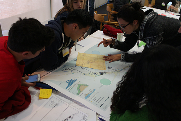 students working around a water map