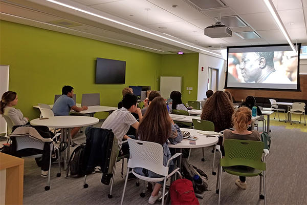 students viewing a film at The Language Center
