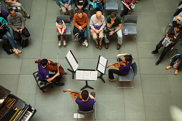 Students at Arts First performing in front of an audience at the Harvard Art Museums