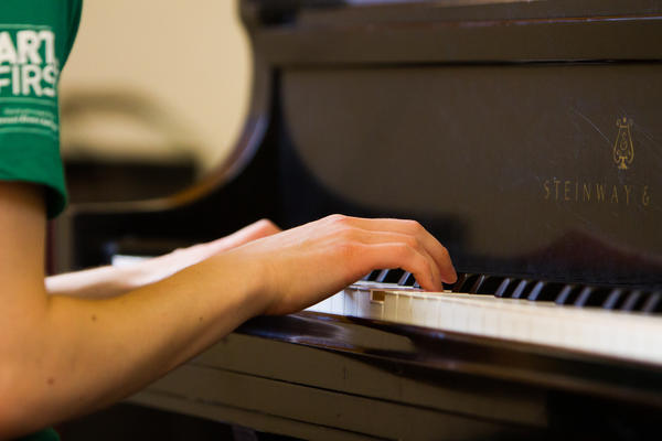 Detail photo of a student playing the piano
