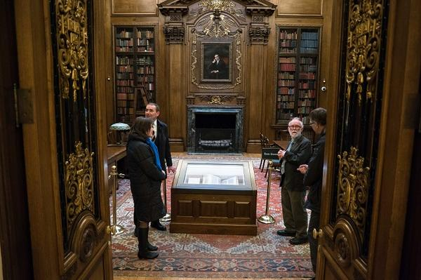 Research Librarian Fred Burchsted shows the President and First Lady the Memorial Room inside Widener Library