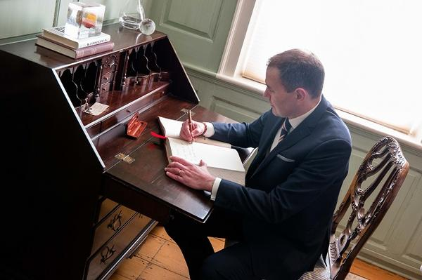 President Johannesson signs the university guest book