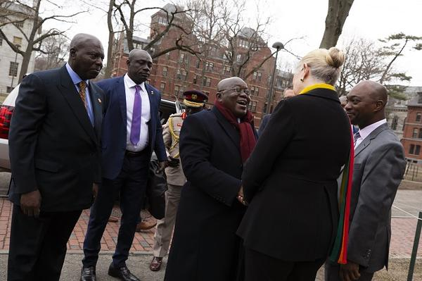 Margot Gill and Emmanuel Akyeampong greet President Akufo-Addo upon arrival in Harvard Yard