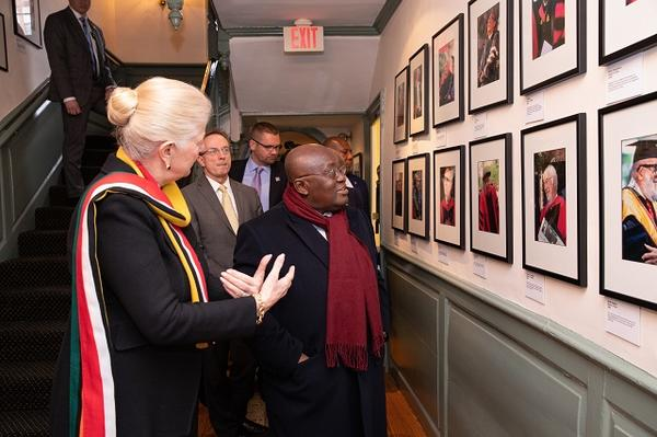 Margot Gill shows President Akufo-Addo photos of past Commencement speakers at Wadsworth House
