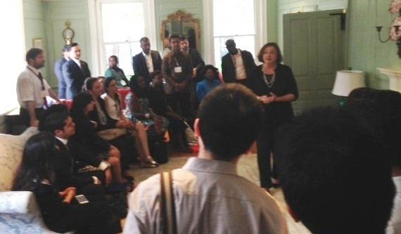 University Marshal Jackie O'Neill speaks with Mason Fellows in the Wadsworth House parlor.