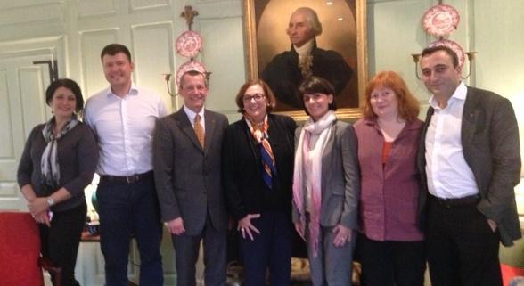Dean Andrei Sharonov, to Jackie O'Neill's left, and colleagues in the Wadsworth House parlor