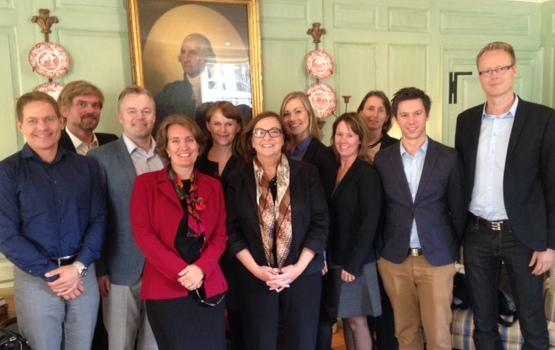 Delegation from Kristiania University College poses with Jackie O'Neill in the Wadsworth House parlor.