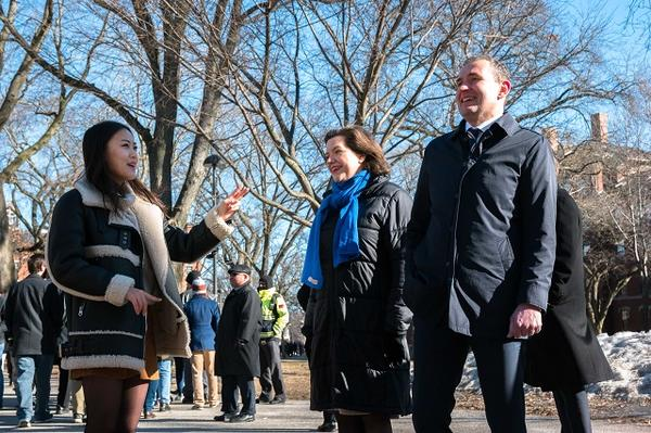 Student tour guide Yena Cho gives a tour of Harvard Yard to the President and First Lady
