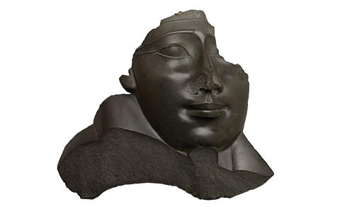 Ancient Egyptian bust with nose broken off.