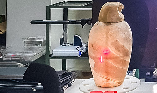 Canopic Jar being scanned for content.