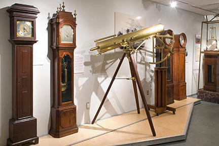 Gallery with grandfather clocks and telescopes.