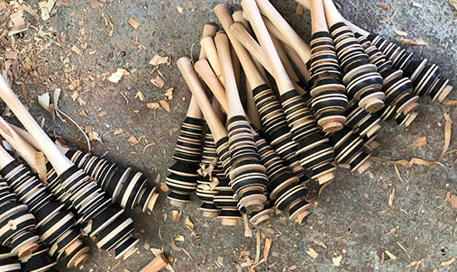 A selection of molinillos, a whisk-like wooden tool used in Mexico to froth in chocolate beverages.