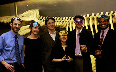 Students in front of the kronosaurus in the Harvard Museum of Natural History
