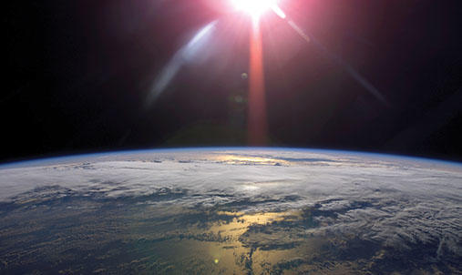 A picture of Earth and the Sun in space.