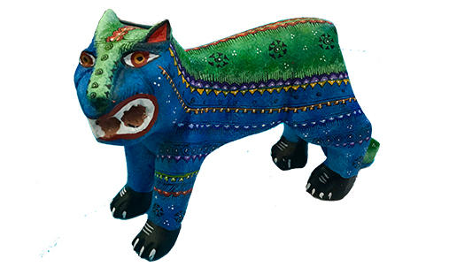 Wooden tiger sculpture painted in blue and green with yellow spots.