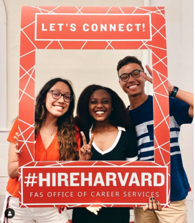 Students holding Hireharvard photoframe