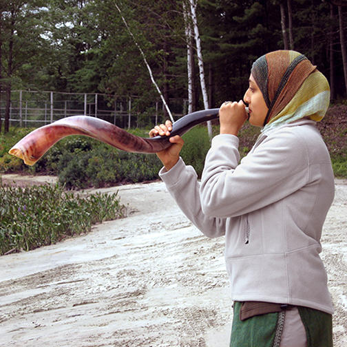 Muslim Youth Leader Blows a Shofar During a Jewish Education Activity