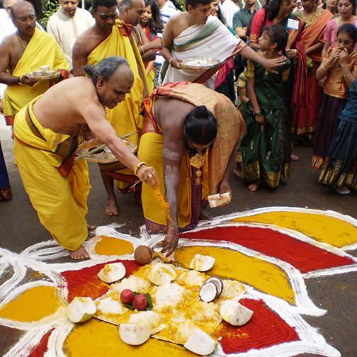 Priests Perform a Ritual around the Rangoli Pattern