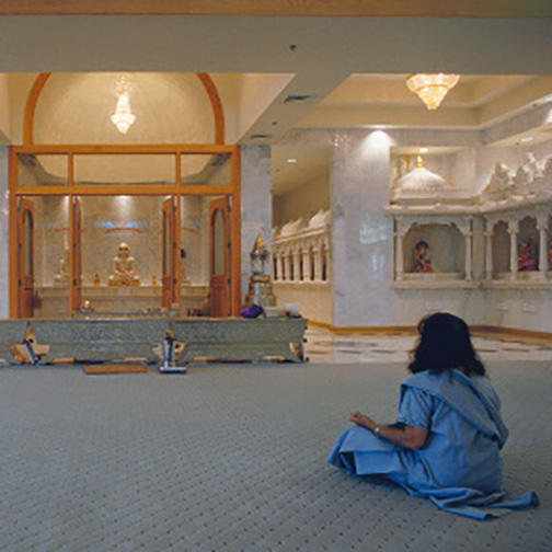 Woman Sitting in Prayer Hall