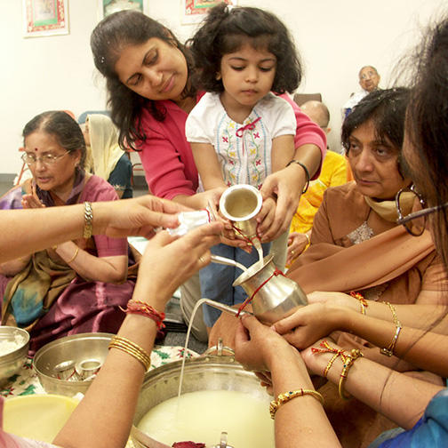 Women of the Sangh Performing Snatra Puja Ablutions