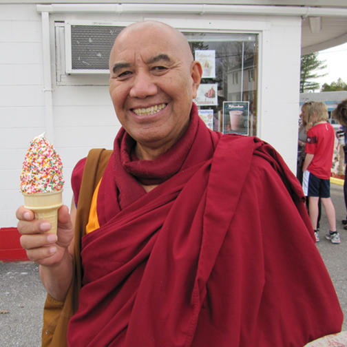 Buddhism monk eating ice cream with sprinkles