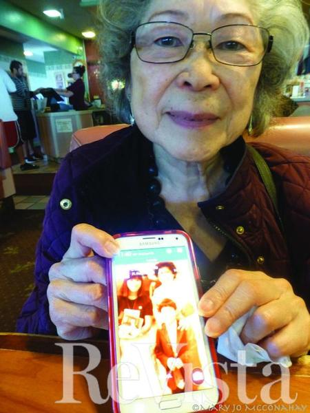 Liba Maoki with a photo of her son