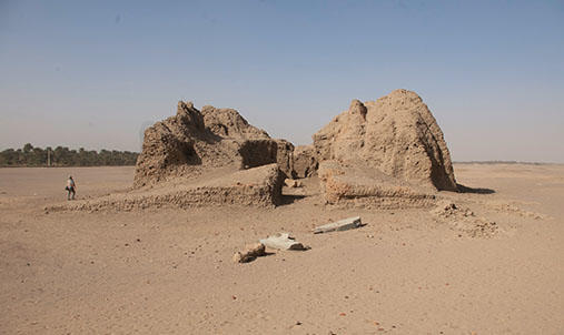 Two large stone structures in the desert.