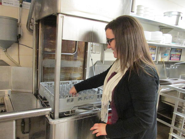 As a shift manager, Hailey checks the kitchen equipment behind to scenes to make sure everything is up to par.