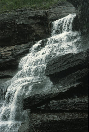 View from under ledge of Upper High Falls  Photograph by Carlton E. Brett