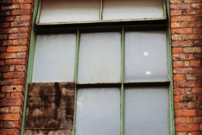 Window with a boarded up pane