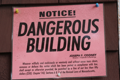 Dangerous building sign hands outside of a Chelsea Massachusetts home