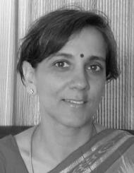 black and white photo of a smiling Indian woman