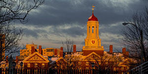 Sunset on snowy Harvard - Gazette photo