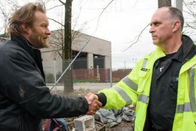 Firefighter and man shaking hands