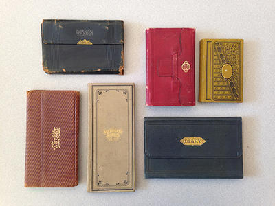 An array of colorful diaries kept by Universalist missionary, Quillen Shinn (bMS 510/1)