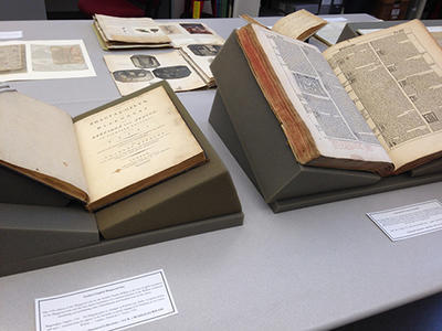 Photograph of rare books and archival collections displayed for a class visit
