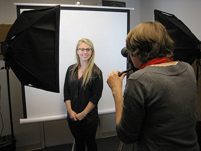 photograph of LinkedIn photobooth with smiling student